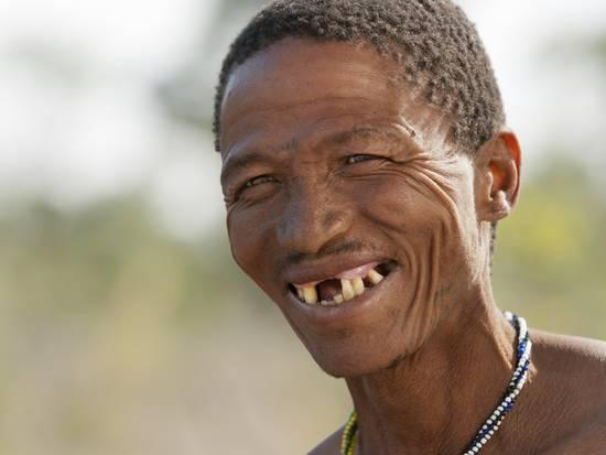kim-walker-smiling-jul-hoan-kung-bushman-on-hunter-gatherer-expedition-bushmanland-kalahari-desert-namibia_a-l-9374627-4990875